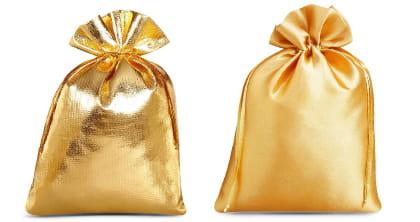 Ex libris pakujemy na prezent w eleganckie złote woreczki.